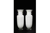 A PAIR OF WHITE GLASS VASES