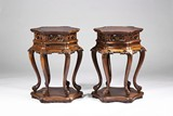 A PAIR OF HARDWOOD CARVED TABLE-FORM STANDS