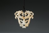 A CARVED JADE 'TWO DRAGONS' PENDANT