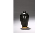A BLACK GLAZED VASE MEIPING
