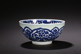 A LARGE BLUE AND WHITE FLORAL DECORATED BOWL
