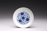 A BLUE AND WHITE 'FLORAL SCROLL' DISH