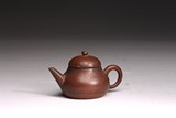 A SMALL YIXING CLAY TEAPOT
