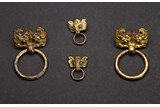 A GROUP OF FOUR GILT BRONZE MASK AND RING HANDLES