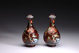 A PAIR OF ENAMELLED 'POMEGRANATE' RED GLASS VASES