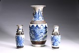 A GROUP OF THREE BLUE AND WHITE CARVED VASES