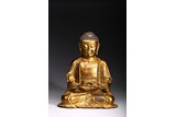 A GILT BRONZE FIGURE OF SEATED AMITABHA