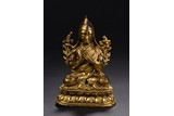 A GILT-BRONZE FIGURE OF TSONGKHAPA