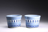 A PAIR OF BLUE AND WHITE 'FU SHOU' JARDINIERES