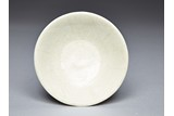 A WHITE GLAZED DISH