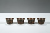 A GROUP OF FOUR BRONZE CUPS