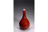 A COPPER RED GLAZED BOTTLE VASE