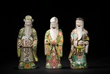 A SET OF THREE FAMILLE ROSE FU LU SHOU FIGURES