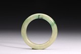 A JADEITE CARVED BANGLE BRACELET
