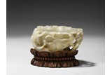 A WHITE JADE 'PLUM BLOSSOM AND CHILONG' WASHER W/ STAND