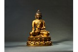 A GILT BRONZE FIGURE OF BHAISAJYAGURU BUDDHA
