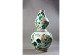 A FAMILLE VERTE 'EIGHT IMMORTALS' DOUBLE GOURD VASE