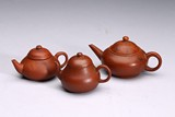 A GROUP OF THREE YIXING CLAY TEAPOTS