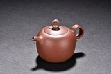 A YIXING TEAPOT WITH FOUR CHARACTER MARK