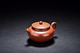 A YIXING RED CLAY TEAPOT