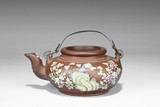 A PAINTED 'PLUM BLOSSOM' YIXING TEAPOT