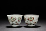 A PAIR OF FAMILLE ROSE 'NINE PEACHES' CUPS