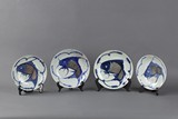 A SET OF FOUR BLUE AND WHITE 'CARP' DISHES
