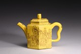 A YELLOW-GLAZED 'EIGHT IMMORTALS' YIXING TEAPOT