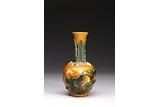 A YELLOW GLAZE CARVED 'LOTUS' VASE