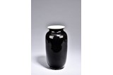 A BLACK GLAZED VASE