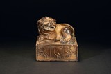 A GILT BRONZE BRONZE SEAL WITH LION-SHAPED TOP