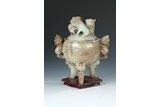 A CARVED 'MYTHICAL BEASTS' JADE TRIPOD CENSER