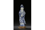 A BLUE AND WHITE FIGURE OF STANDING GUANYIN