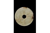 A WHITE JADE ARCHAISTIC DISC PENDANT