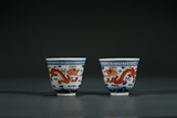 A PAIR OF CHINESE FAMILLE ROSE 'DRAGON' WINE CUPS