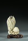 A CHINESE WHITE JADE CARVING OF BUDDHA'S HAND