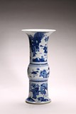 A CHINESE BLUE AND WHITE 'FIGURES' GU VASE