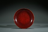 A RED GLAZED DISH