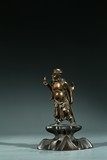 A CHINESE PARCEL-GILT BRONZE FIGURE OF TIE GUAILI