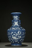 A BLUE AND WHITE RESERVE-DECORATED 'FLOWER' VASE