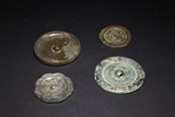 A SET OF FOUR ARCHAIC BRONZE MIRRORS