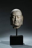 A LIMESTONE CARVED HEAD OF LUOHAN