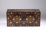A CHINESE RED LACQUER GILT PAINTED TRUNK
