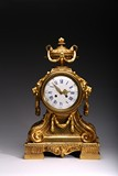 A LOUIS XVI STYLE GILT BRONZE MANTLE CLOCK