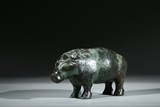 AN ARCHAIC BRONZE FIGURE OF STANDING PIG