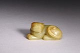 A YELLOW JADE CARVED RECUMBENT MYTHICAL BEAST