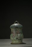 A CHINESE BRONZE 'TAOTIE' WINE VESSEL AND COVER