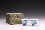 A PAIR OF BLUE AND WHITE 'BIRDS' CUPS