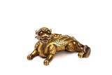A CHINESE GILT BRONZE 'BUDDHIST LION' PAPER WEIGHT