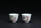 A PAIR OF FAMILLE-ROSE 'FLOWER' CUPS